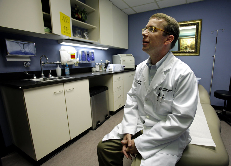 Photo - Dr. Daniel Isbell talks about hernia repair  in Norman.  Photo by Steve Sisney, The Oklahoman
