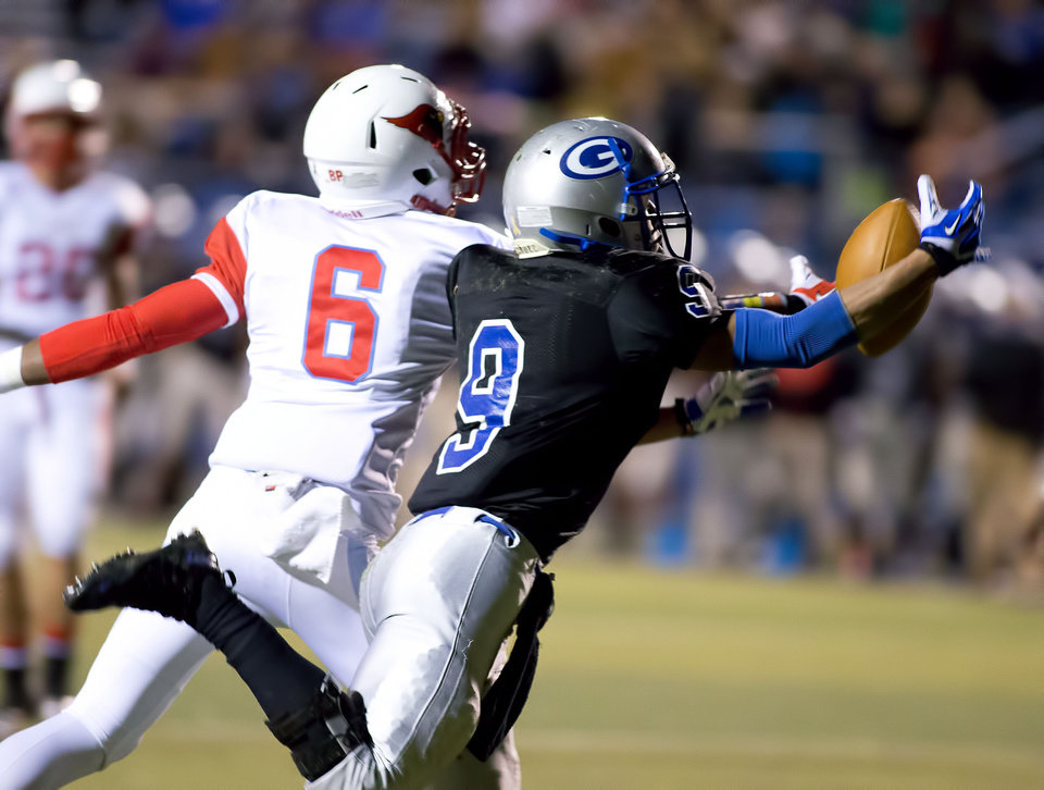 Photo - Guthrie defensive back Kai Callins (9) intercepts a pass during the class 5A high school playoffs between Collinsville and Guthrie at Sapulpa HS on November 29, 2013.   JOEY JOHNSON/For the Tulsa World