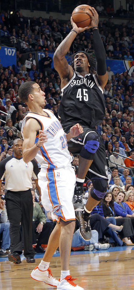 Photo - Brooklyn Nets' Gerald Wallace (45) drives past Oklahoma City's Kevin Martin (23) during the NBA basketball game between the Oklahoma City Thunder and the Brooklyn Nets at the Chesapeake Energy Arena on Wednesday, Jan. 2, 2013, in Oklahoma City, Okla. Photo by Chris Landsberger, The Oklahoman