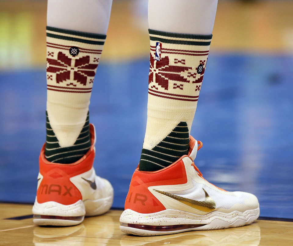 Photo - Oklahoma City's Enes Kanter (11) wears socks with a Christmas sweater pattern during an NBA basketball game between the Oklahoma City Thunder and the Chicago Bulls at Chesapeake Energy arena in Oklahoma City, Friday, Dec. 25, 2015. Photo by Nate Billings, The Oklahoman
