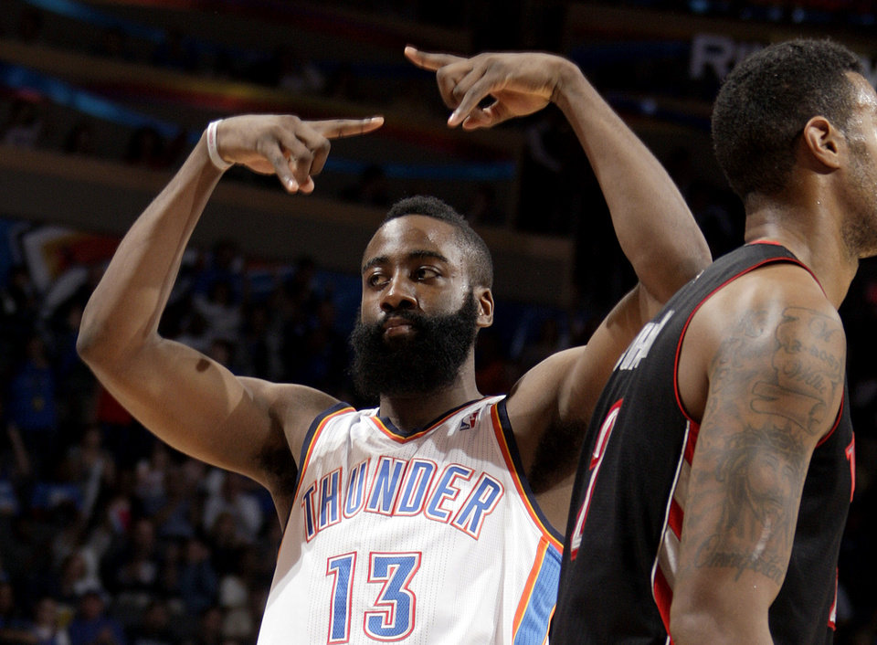 Oklahoma City\'s James Harden (13) celebrates a three-pointer during the NBA basketball game between the Oklahoma City Thunder and the Toronto Raptors at Chesapeake Energy Arena in Oklahoma City, Sunday, April 8, 2012. Photo by Sarah Phipps, The Oklahoman.
