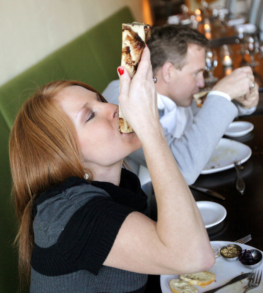 Erica Millar and her husband, Kyle Millar, try a Bone Marrow Luge at Ludivine in Oklahoma City, Thursday, Feb. 16, 2012. Photo by Nate Billings, The Oklahoman