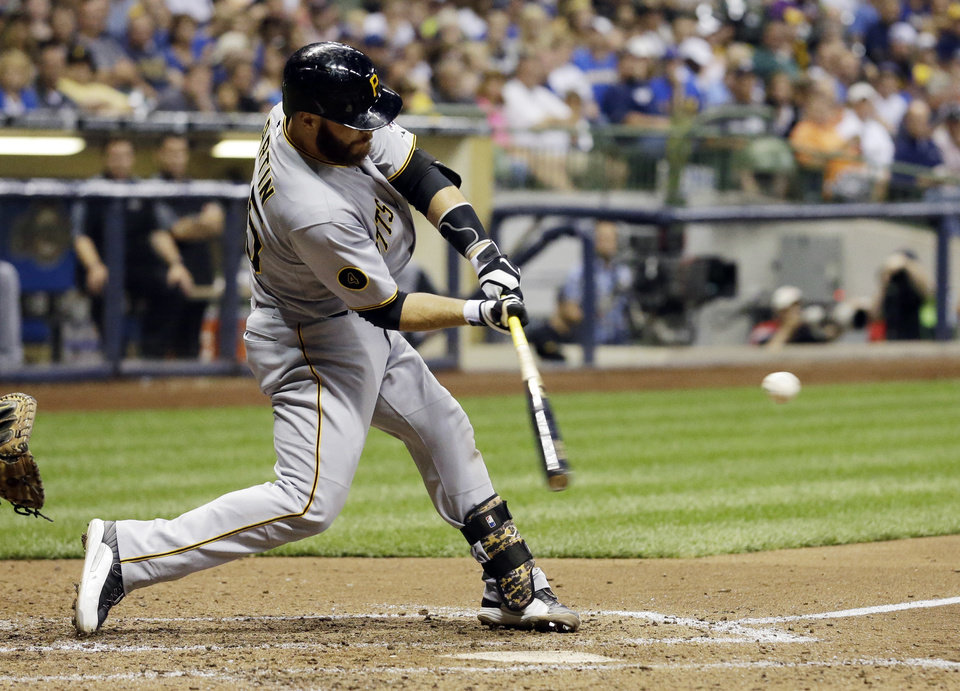 Photo - Pittsburgh Pirates' Russell Martin hits a three-run home run during the fifth inning of a baseball game against the Milwaukee Brewers pm Saturday, Aug. 23, 2014, in Milwaukee. (AP Photo/Morry Gash)