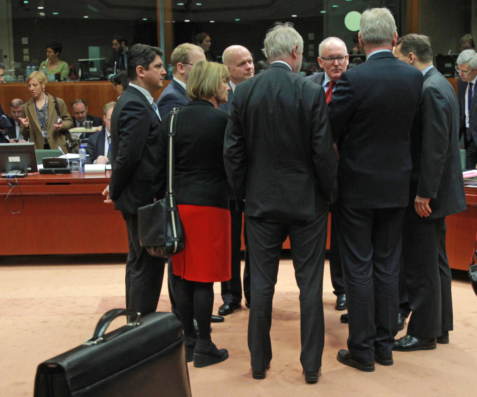 Photo - EU foreign ministers talk to each other prior to the start of the EU foreign ministers council at the European Council building in Brussels, Monday, March 17, 2014. British Foreign Secretary William Hague says he is confident that the European Union will ratchet up pressure on Russia over its role in the breakaway of Ukraine's Crimea region by imposing sanctions on people linked to the secession of the peninsula. The 28-nation EU condemned the Crimea referendum which overwhelmingly backed a return to Russia, and the EU foreign ministers were assessing on Monday who to target for asset freezes and travel bans. (AP Photo/Yves Logghe)