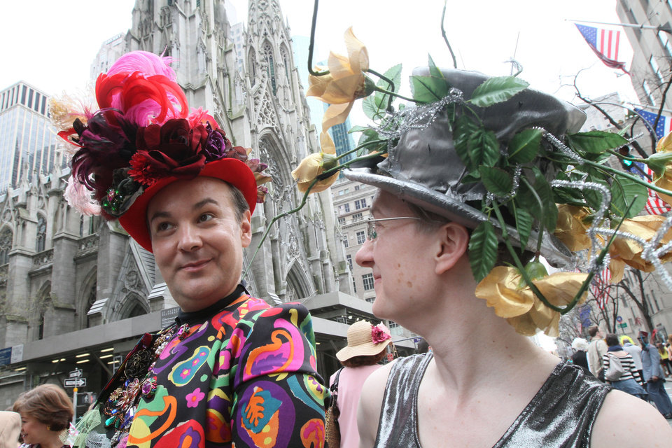 Photo -   Wearing hats, Christian Freedom, left, and Amy Russell pose for photographers as they take part in the Easter Parade along New York's Fifth Avenue Sunday April 24, 2011. (AP Photo/Tina Fineberg)