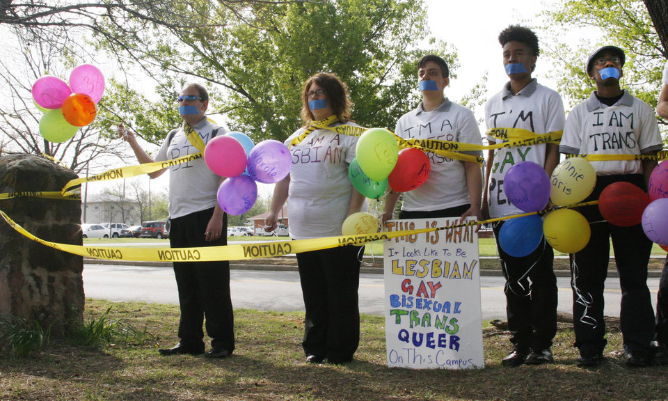 A group has their mouthes taped shut while holding balloons during the Equality Ride hosted by Soulforce on the campus of Oklahoma Baptist University in Shawnee Wednesday March 28, 2012. Photo by Silas Allen, The Oklahoman