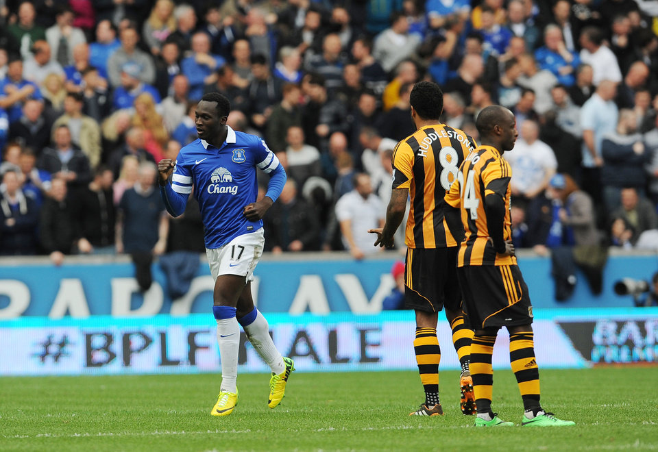 Photo - Everton's Romelu Lukaku, left, celebrates after scoring his side's second goal during their English Premier League soccer match at KC Stadium, Hull, England, Sunday, May 11, 2014. (AP Photo/Anna Gowthorpe, PA Wire)     UNITED KINGDOM OUT   -   NO SALES   -   NO ARCHIVES