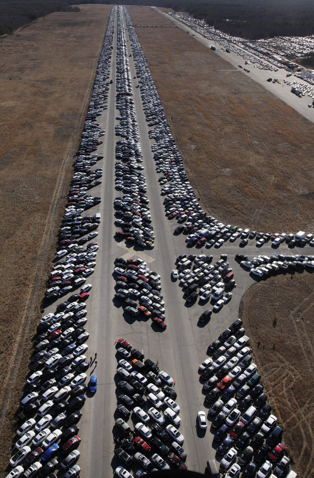 This Friday, Jan. 18, 2013 aerial photo shows thousands of cars which were damaged in the Oct. 29, 2012 Superstorm Sandy and stored on the runways at Calverton Executive Airpark in Calverton, N.Y. Environmentalists are decrying the placement of the 18,000 damaged automobiles at the defunct defense plant on eastern Long Island near the environmentally protected Pine Barrens. The town supervisor in Riverhead disputes the idea that there is any hazard. The town leased the runways to salvage companies and could reap up to $2.7 million under the lease agreement. (AP Photo/Mark Lennihan)