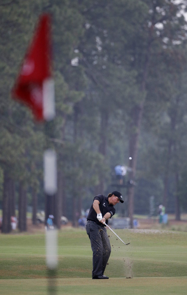 Photo - Phil Mickelson hits from the fairway on the 10th hole during the first round of the U.S. Open golf tournament in Pinehurst, N.C., Thursday, June 12, 2014. (AP Photo/David Goldman)