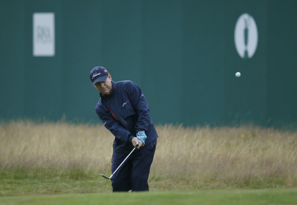 Photo - Tom Watson of the US chips onto the 18th green during the third day of the British Open Golf championship at the Royal Liverpool golf club, Hoylake, England, Saturday July 19, 2014. (AP Photo/Alastair Grant)