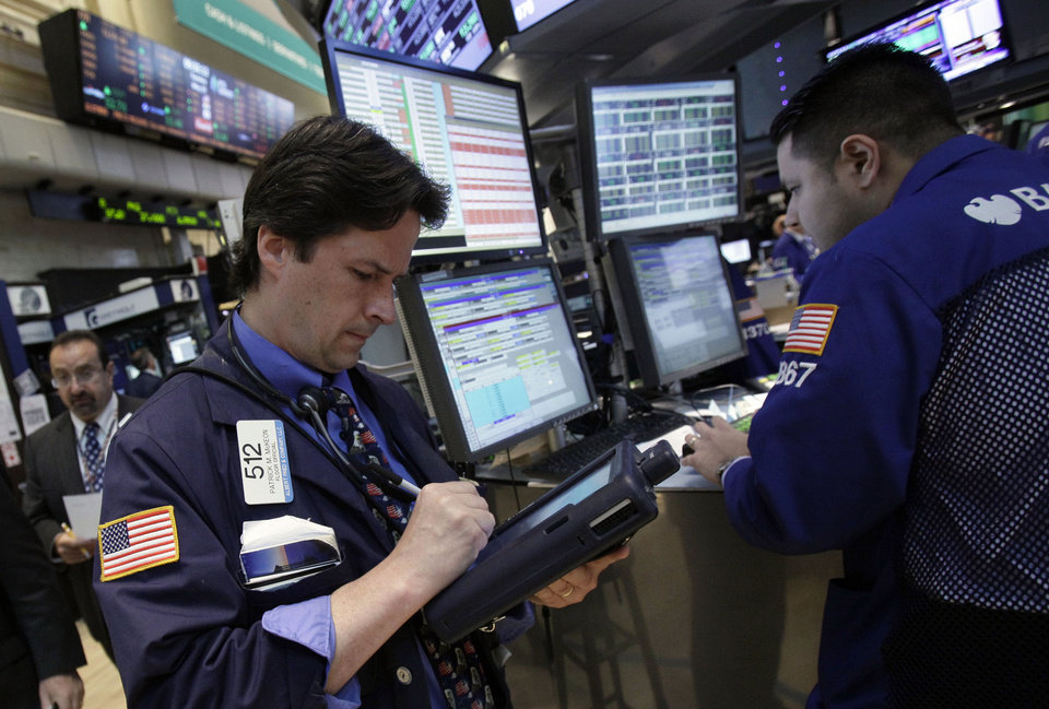 Photo -   In a May 29, 2012 photo trader Patrick McKeon, left, works on the floor of the New York Stock Exchange. Futures augured a lower opening on Wall Street Monday June 18, 2012 with Dow Jones industrial futures and S&P 500 futuresboth down 0.4 percent (AP Photo/Richard Drew)