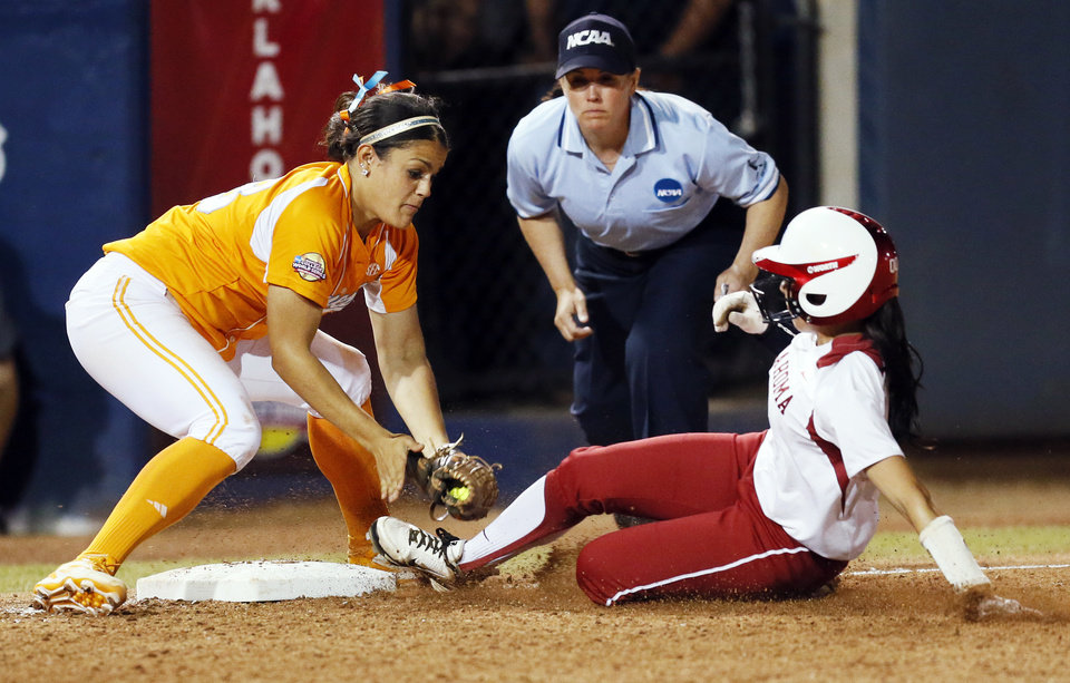 Photo - OU's Destinee Martinez (00) slides into third base to triple as Tennessee's Raven Chavanne (88) tries to make the tag in the eleventh inning during Game 1 of the Women's College World Series NCAA softball championship series between Oklahoma and Tennessee at ASA Hall of Fame Stadium in Oklahoma City, Monday, June 3, 2013. OU won 5-3 in 12 innings. Photo by Nate Billings, The Oklahoman