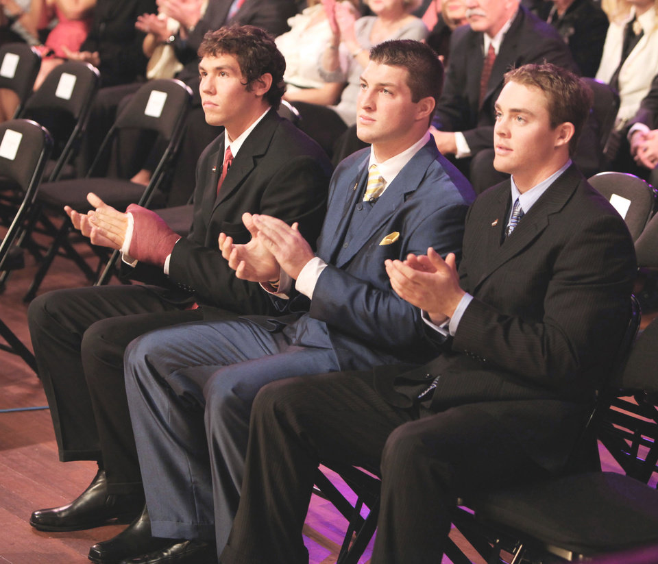 College football pundit Beano Cook was upset that Florida quarterback Tim Tebow, center, was left off some Heisman Trophy ballots.  AP Photo