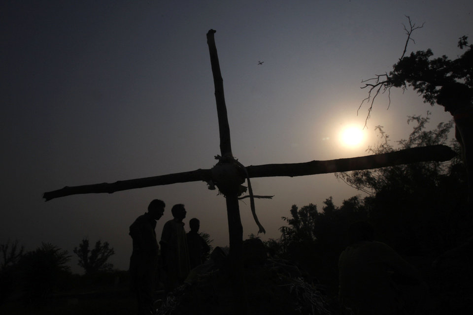Photo - Pakistani Christians attend the funeral of their family members at a local grave yard in Peshawar, Pakistan, Monday, Sept. 23, 2013. Angry Pakistani Christians denounced the deadliest attack ever in this country against members of their faith. A pair of suicide bombers blew themselves up amid hundreds of worshippers outside a historic church in northwestern Pakistan. (AP Photo/Mohammad Sajjad)