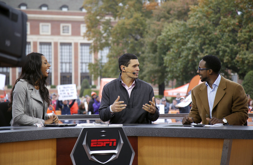 Photo - Maria Taylor, David Pollack and Desmond Howard film College Football Live on the ESPN College GameDay Built by the Home Depot set on the campus of Oklahoma State University in Stillwater, Okla.,  Friday, Nov. 3, 2017. Photo by Sarah Phipps, The Oklahoman