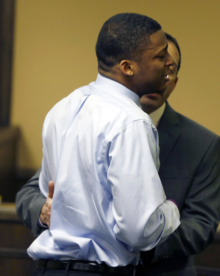 Ma'lik Richmond, left, is helped by Fred Abdalla Jr., chief probation officer for the Jefferson County juvenile court, as he cries while apologizing to the victim and her family after he and co-defendant Trent Mays were found delinquent on rape and other charges after their trial in juvenile court in Steubenville, Ohio, Sunday, March 17, 2013. Mays and Richmond were accused of raping a 16-year-old West Virginia girl in August 2012. (AP Photo/Keith Srakocic, Pool)