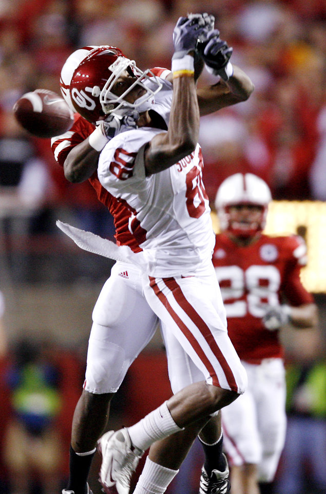 Photo - Oklahoma's Adron Tennell (80) has a pass broken up by Nebraska's Prince Amukamara (21) during the second half of the college football game between the University of Oklahoma Sooners (OU) and the University of Nebraska Cornhuskers (NU) on Saturday, Nov. 7, 2009, in Lincoln, Neb.