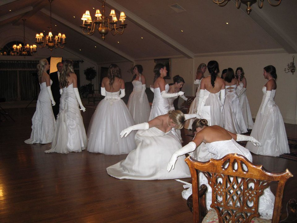 BEAUX ARTS BALL....Debutantes practice their deep bows before their  introductions as the 2009 debutantes at the Beaux Arts Ball. (Photo  by Helen Ford Wallace).