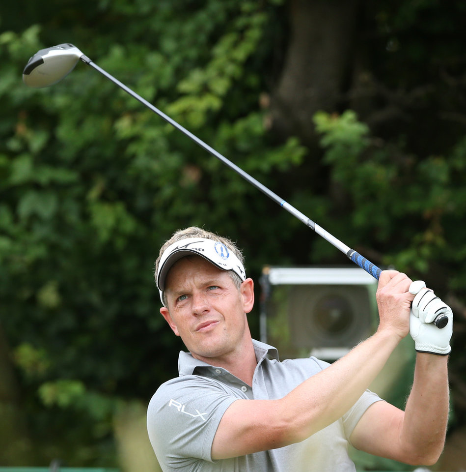 Photo - Luke Donald of England plays a shot off the 18th tee during a practice round ahead of the British Open Golf championship at the Royal Liverpool golf club, Hoylake, England, Wednesday July 16, 2014. The British Open Golf championship starts Thursday July 17. (AP Photo/Jon Super)