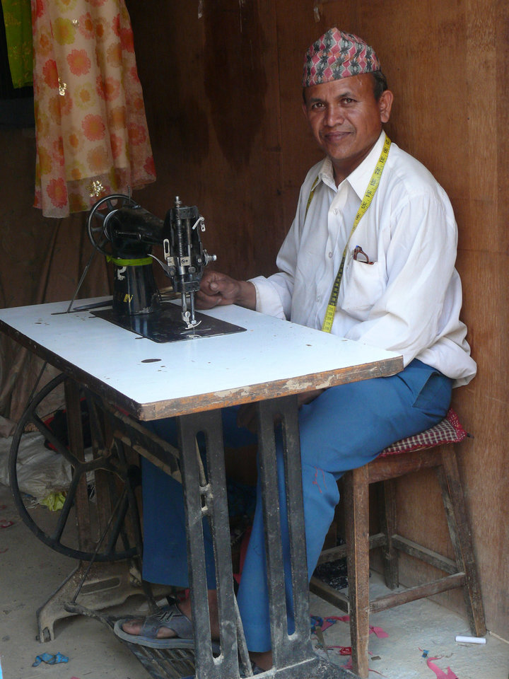 A man sits at a sewing machine in Nepal, a South Asian country. World Neighbors has worked with locals to help them achieve social and economic empowerment (especially among women and the poor), conserve natural resources, decrease child malnutrition and more. <strong> - World Neighbors</strong>