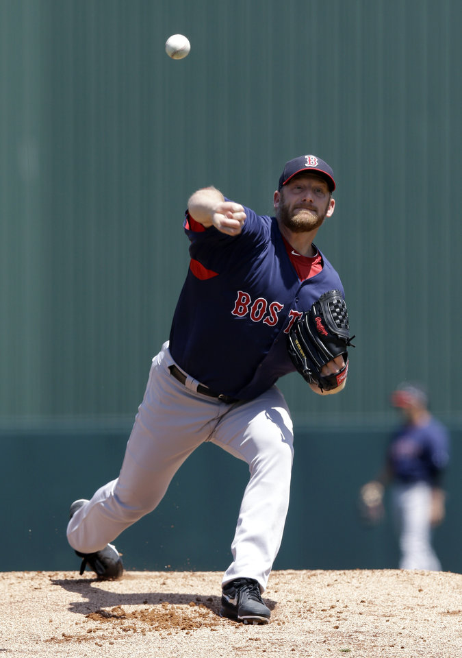 Photo - Boston Red Sox starting pitcher Ryan Dempster warms up for the first inning of an exhibition spring training baseball game against the Minnesota Twins in Fort Myers, Fla., Friday, March 29, 2013. (AP Photo/Elise Amendola)