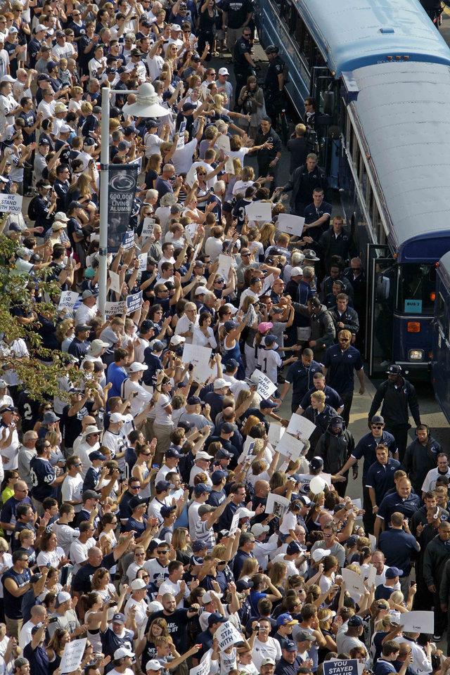 Photo -   Penn State football fans cheer for the Penn State football team as they arrives by bus at Beaver Stadium for their season opener against Ohio in State College, Pa., Saturday, Sept. 1, 2012. Penn State fans ushered in a new era in the football program with a raucous ovation as the team stormed the field for their first game under coach Bill O'Brien. (AP Photo/Gene J. Puskar)