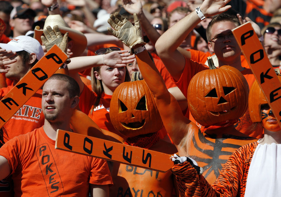 Photo - Fans cheer during a college football game between the Oklahoma State University Cowboys (OSU) and the Baylor University Bears (BU) at Boone Pickens Stadium in Stillwater, Okla., Saturday, Oct. 29, 2011. Photo by Sarah Phipps, The Oklahoman