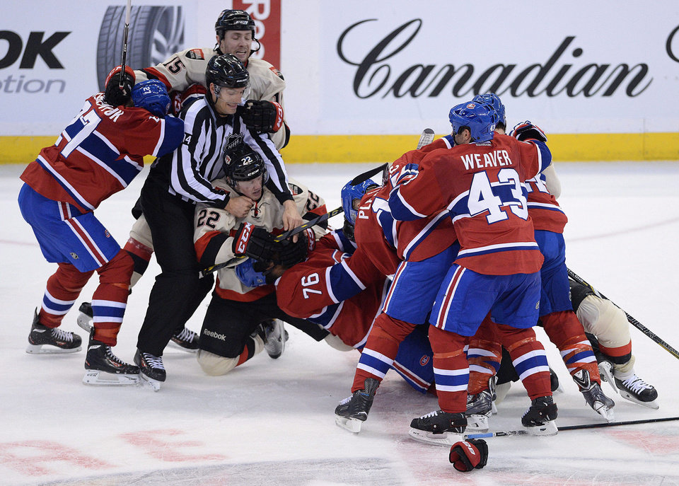 Photo - The Ottawa Senators and Montreal Canadiens fight during second period NHL hockey action in Ottawa on Friday, April 4, 2014. (AP Photo/The Canadian Press, Sean Kilpatrick)