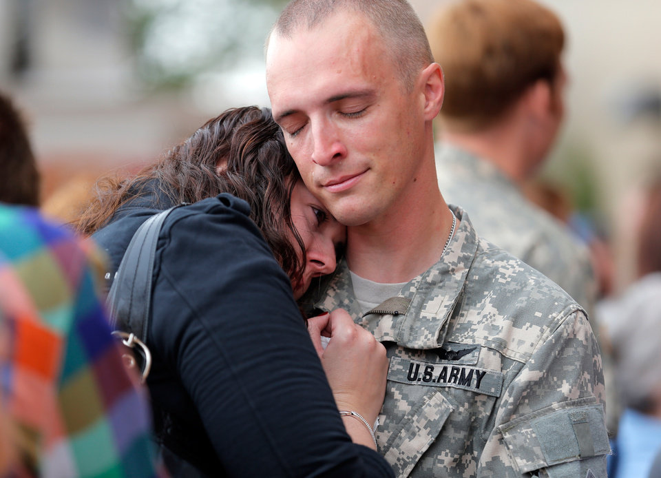 Warrant Officer Ryan Johnson  hugs his wife, Kyra, goodbye following an Oklahoma Aviation Command mobilization ceremony  for Detachment 1, Company C, 2-149th General Support Aviation Battalion at the Army Aviation Support Facility in Lexington, Okla., Sunday, Sept. 16, 2012. The soldiers will receive additional training at Fort Hood before being deployed to Afghanistan. Photo by Sarah Phipps, The Oklahoman