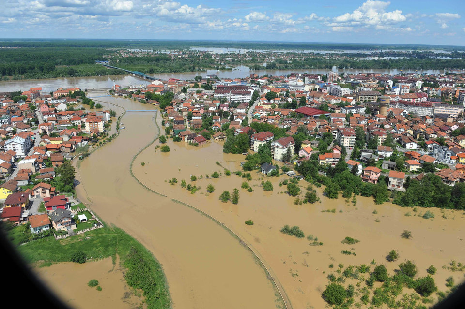 Photo - This image taken on taken Sunday, May 18, 2014 and made available by the Bosnia Army shows an aerial view of the flooded area near the Bosnian town of Brcko along the river Sava, 200 kms north of Bosnian capital of Sarajevo. Three months' worth of rain fell on the Balkan region in three days, producing the worst floods since rainfall measurements began 120 years ago. (AP Photo/Bosnia Army)