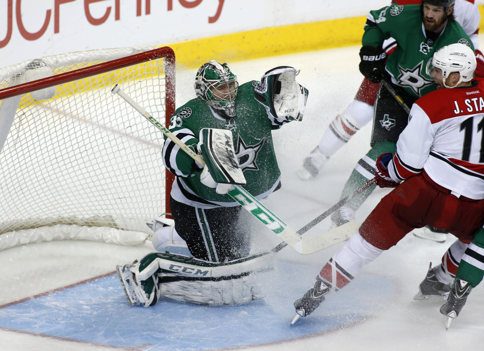 Photo - Dallas Stars goalie Kari Lehtonen (31), of Finland, makes the save as defenseman Jordie Benn (24) and Carolina Hurricanes center Jordan Staal (11) watch during the second period of an NHL hockey game on Thursday, Feb. 27, 2014, in Dallas. (AP Photo/Sharon Ellman)