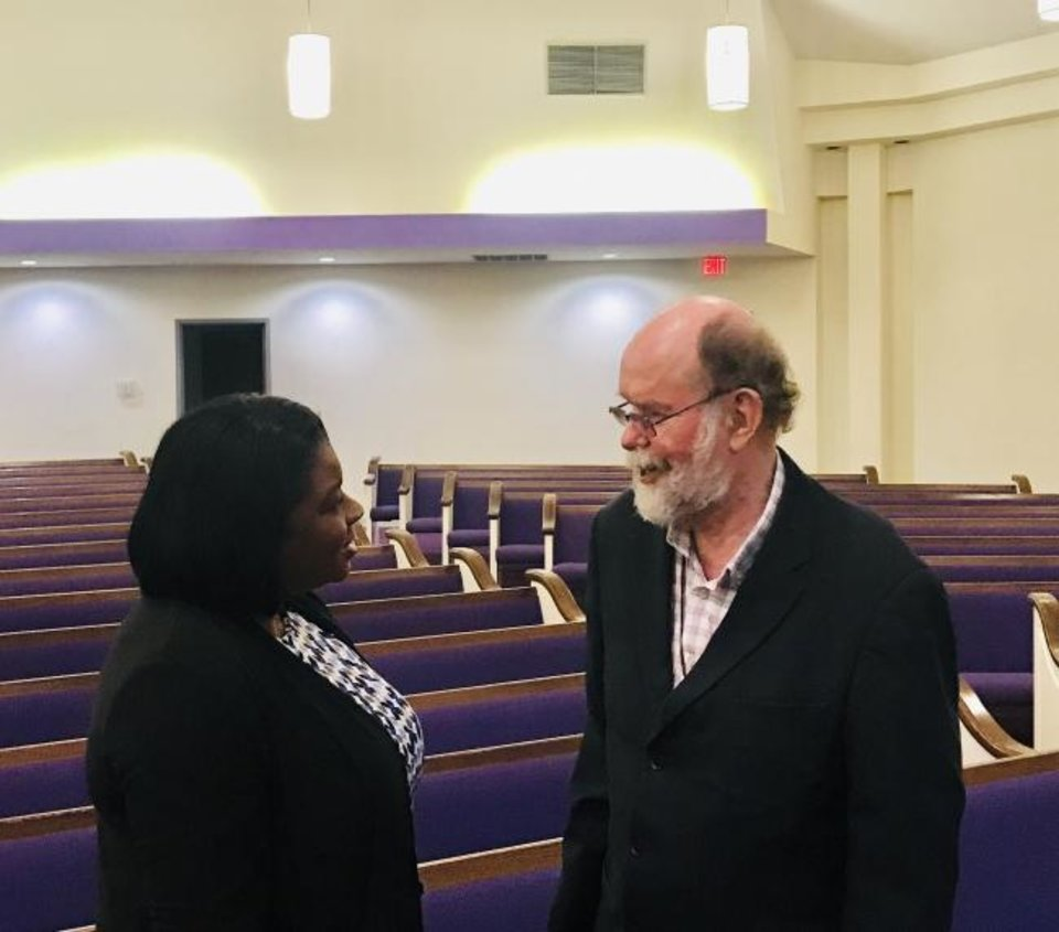 Photo -  Paula Bowen of Lawton talks with South African Anglican priest Michael Lapsley after Lapsley's presentation on Monday at Fairview Baptist Church in northeast Oklahoma City. [Carla Hinton/The Oklahoman]
