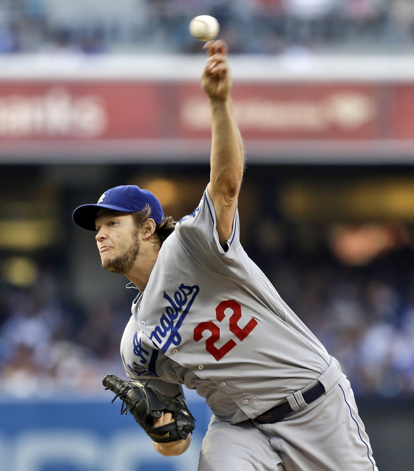 Photo - Los Angeles Dodgers starting pitcher Clayton Kershaw deliveres against the San Diego Padres in the first inning of a baseball game Saturday, Sept. 21, 2013, in San Diego. (AP Photo/Lenny Ignelzi)