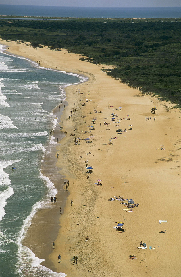 In this photo, provided by the Outer Banks Visitors Bureau, guests line Buxton Beach in the Outer Banks of North Carolina. Cape Hatteras is on the list of Top 10 beaches produced annually. (AP PHOTO)