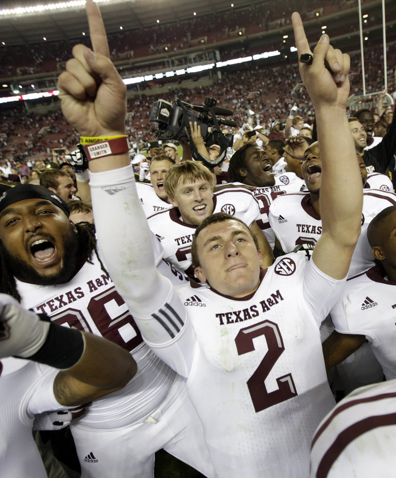 Photo -   Texas A&M quarterback Johnny Manziel (2) celebrates after the Aggies defeated top-ranked Alabama 29-24 in an NCAA college football game at Bryant-Denny Stadium in Tuscaloosa, Ala., Saturday, Nov. 10, 2012. (AP Photo/Dave Martin)