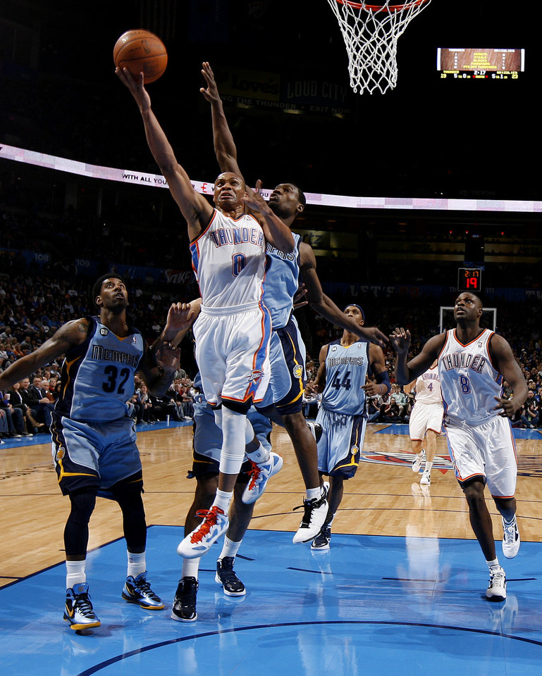 Oklahoma City\'s Russell Westbrook (0) goes to the basket between Memphis\' O.J. Mayo (32) and Tony Allen (9) during the NBA game between the Oklahoma City Thunder and the Memphis Grizzlies at Chesapeake Energy Arena in Oklahoma CIty, Friday, Feb. 3, 2012. Photo by Bryan Terry, The Oklahoman