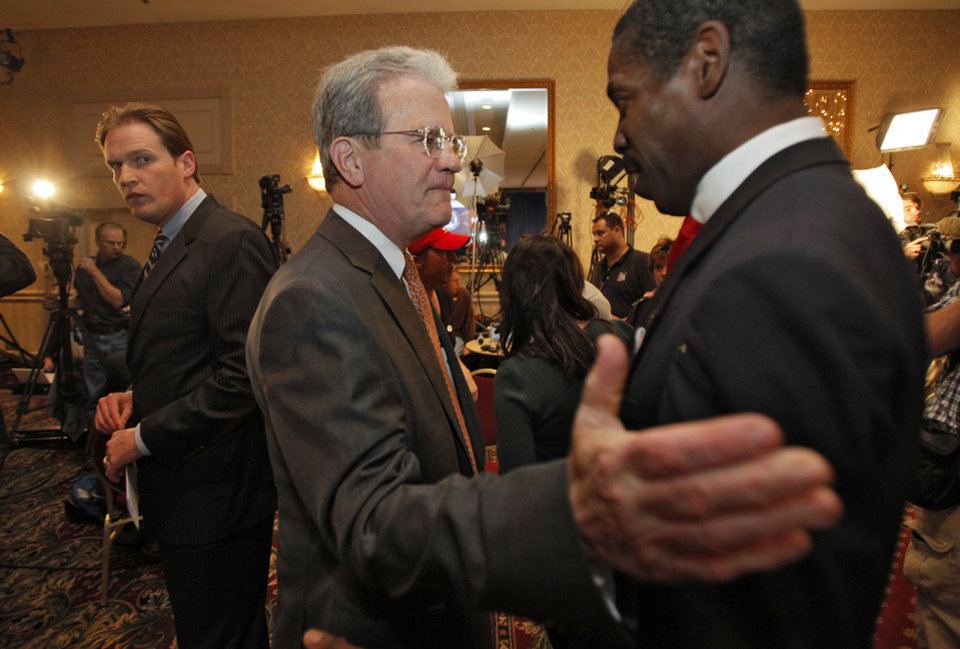 Photo - U.S. Senator Tom Coburn talks to Harold Roberts at the republican Watch Party at the Marriott on Tuesday, Nov. 2, 2010, in Oklahoma City, Okla.   Photo by Chris Landsberger, The Oklahoman