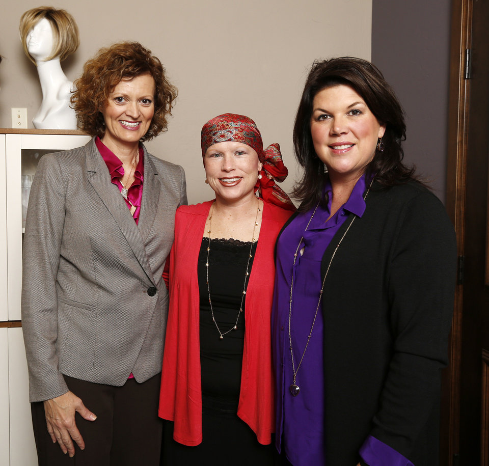 Photo -  Dr. Laura Miles, left, and Janet McLain, right, co-founders of Cancierge, stand with Paige Teel, a cancer patient from Minco. Photo by Paul B. Southerland, The Oklahoman   PAUL B. SOUTHERLAND -