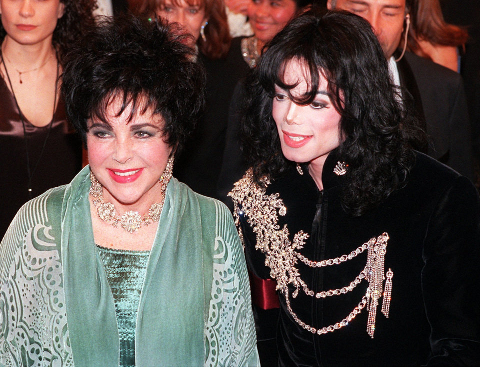 FILE - In this Feb. 16, 1998 file photo, actress Elizabeth Taylor arrives with pop singer Michael Jackson at the Pantages Theater in the Hollywood area of Los Angeles for a birthday celebration for Taylor. (AP Photo/Chris Pizzello, file) ORG XMIT: NYET720