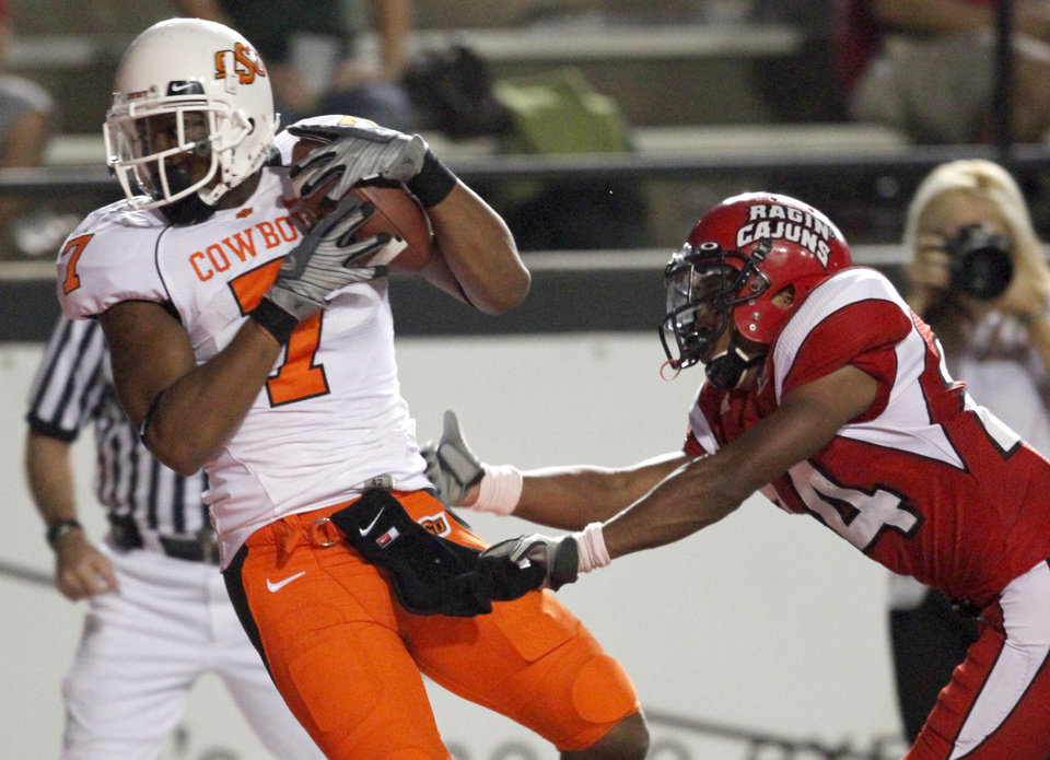Photo - OSU's Michael Harrison catches a touchdown in front of  Louisiana-Lafayette's Lionel Stokes during the football game between the University of Louisiana-Lafayette and Oklahoma State University at Cajun Field in Lafayette, La., Friday, October 8, 2010. Photo by Bryan Terry, The Oklahoman