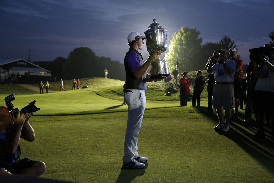 Photo - Rory McIlroy, of Northern Ireland, holds up the Wanamaker Trophy after winning the PGA Championship golf tournament at Valhalla Golf Club on Sunday, Aug. 10, 2014, in Louisville, Ky. (AP Photo/John Locher)