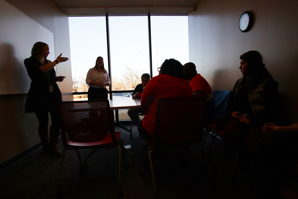 Photo -  Jessica Kelley discusses options and plans Monday as teachers meet in a room at Southern Oaks Library in Oklahoma City to discuss the possibility of a strike. [Photo by Doug Hoke, The Oklahoman]
