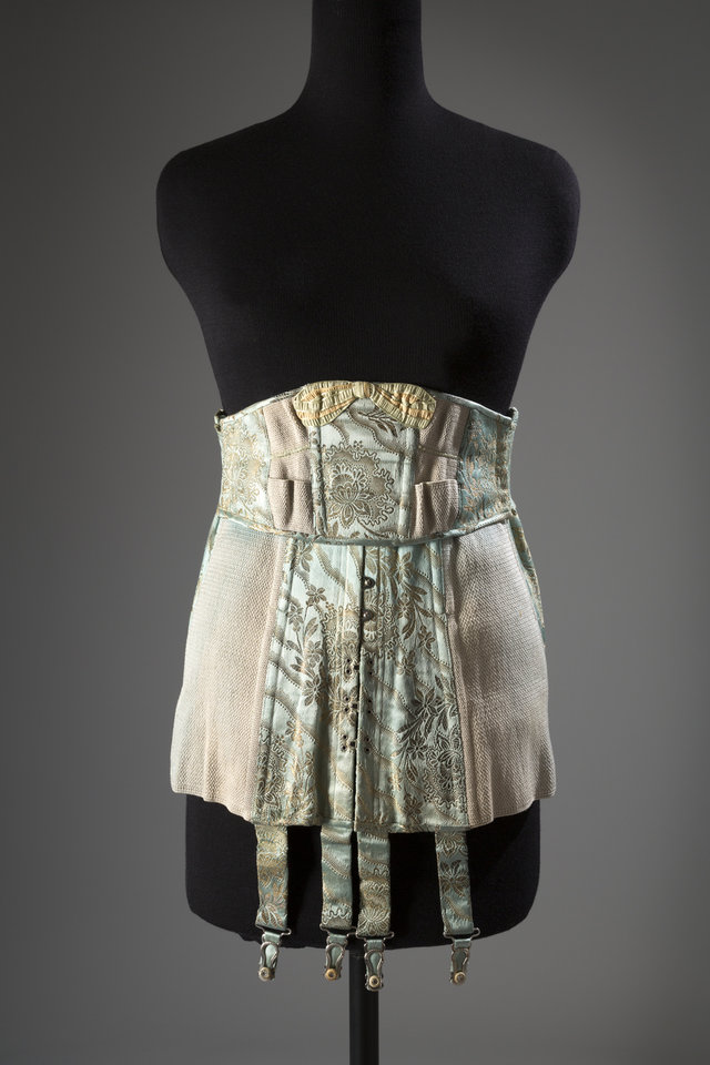Photo - This image released by The Museum at FIT shows a corset in brocade satin and elastic, a U.S. garment, circa 1920 from Strouse, Adler Co. From a 1770 corset to a 2014 bra-and-panty set in lacy stretch silk, the Museum at the Fashion Institute of Technology has taken on lingerie and ladies foundation garments as the focus of a new exhibition. In about 70 pieces,