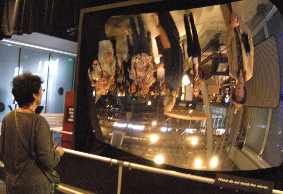 Photo - A curved mirror is part of the fun at the new Exploratorium in San Francisco .Photo courtesy of Patricia Arrigoni.