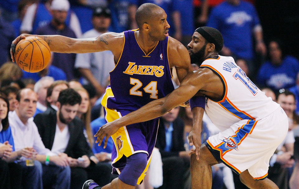 Photo - GAME THREE / L.A. LAKERS: Oklahoma City's James Harden (13) defends Kobe Bryant (24) of L.A. during the NBA basketball game between the Los Angeles Lakers and the Oklahoma City Thunder in the first round of the NBA playoffs at the Ford Center in Oklahoma City, Thursday, April 22, 2010. Photo by Nate Billings, The Oklahoman ORG XMIT: KOD
