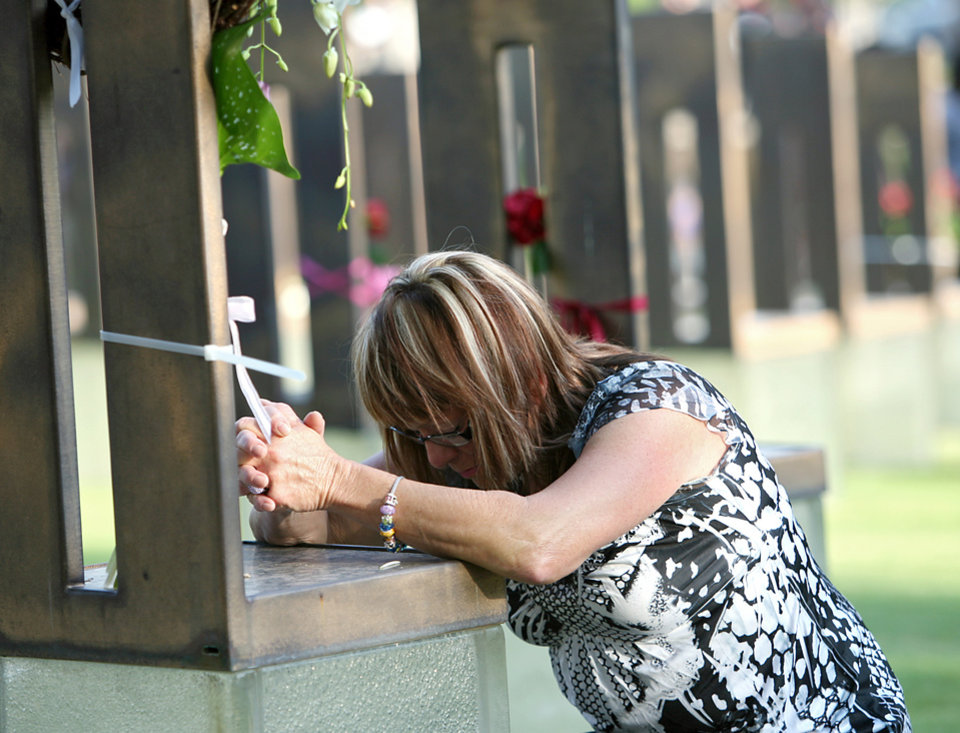 Regina Bonny, of Oklahoma City, spends a moment with a chair dedicated to Shelly Bland during the 16th Annual Day of Remembrance at the Oklahoma City National Memorial and Museum in Oklahoma City, Oklahoma onTuesday, April 19, 2011. Bonny, a survivor of the bombing of the Alfred P. Murrah Building on April 19, 1995, visited the chairs of 5 co-workers who died in the bombing. Photo by John Clanton, The Oklahoman