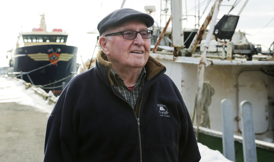 In this photo taken Wednesday, Feb. 13, 2013, Ron Gilson, a 79-year-old life Gloucester native, walks along the fish pier in Gloucester, Mass. In Gilson\'s life he\'s worked throughout the fishing industry from working on the wharf in his youth to a historian on Gloucester in his later life. In May, a massive reduction is coming to the catch limit for cod caught in the Gulf of Maine, just outside Gloucester Harbor, and the cuts are acknowledged by fishermen, regulators and environmentalists to be devastating, and perhaps fatal, for the historic industry. (AP Photo/Charles Krupa)