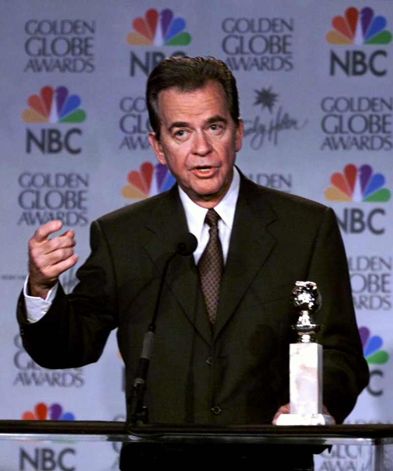 Photo - Entertainer Dick Clark addresses the media prior to announcing the 1999 Golden Globes nominations at the Beverly Hilton in Beverly Hills, Calif., Monday, Dec. 20, 1999. The Golden Globes air Jan. 23 on NBC. (AP Photo/Victoria Arocho)