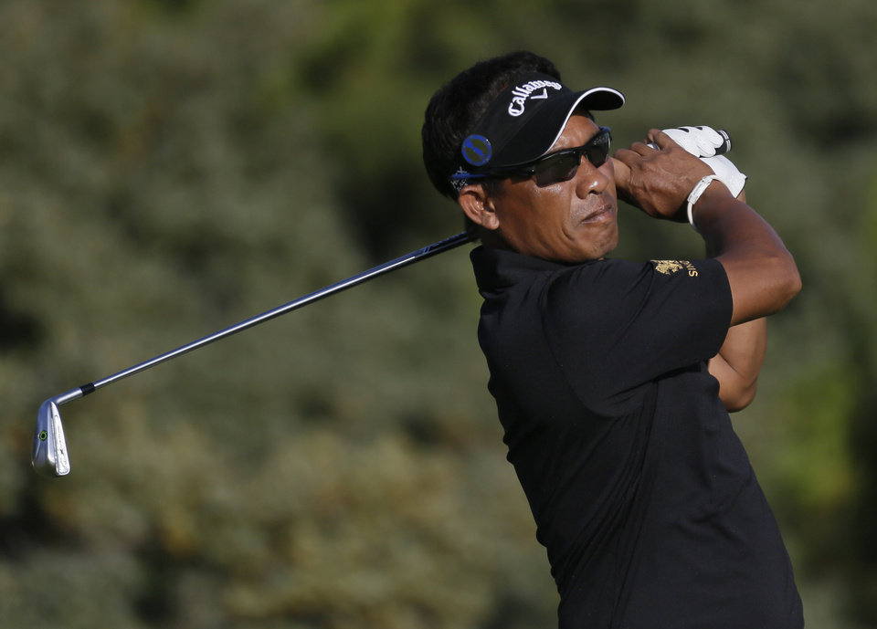 Photo - Thongchai Jaidee of Thailand plays a shot off the third tee during the second round of the British Open Golf Championships at Muirfield, Scotland, Friday July 19, 2013. (AP Photo/Jon Super)