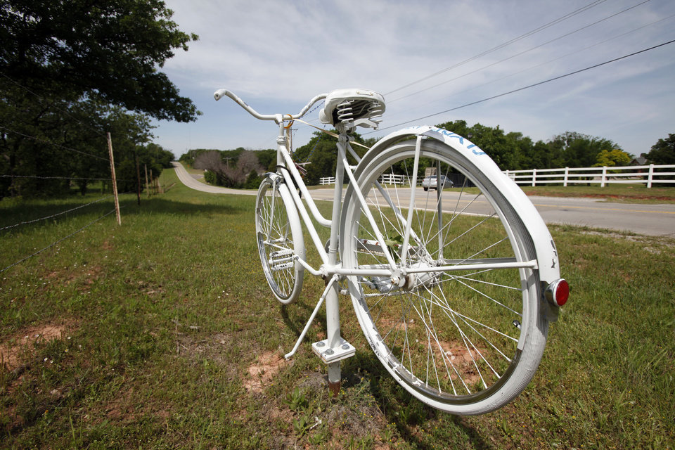 Photo - A bicycle marks the spot as a memorial to a cyclist who was killed in northeast Oklahoma City.  PHOTO BY STEVE GOOCH, THE OKLAHOMAN